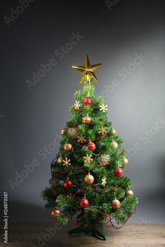 Poster Christmas tree with gold star, grey background