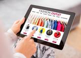 Fashion outlet website on tablet