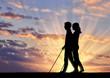 Invalids blind with cane go sunset