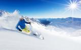 Fototapety Skier on piste running downhill