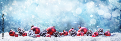 Snowy Christmas Balls And Pinecones In Wintery Scene