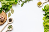 frame spices and fresh herbs on white table top view - 126887799