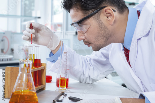 Scientist working with chemical fluid
