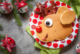 Christmas food for kid. Reindeer pancake