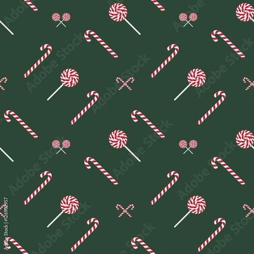 Materiał do szycia Bright fun Christmas seamless pattern with candy sticks and lollipops, sweets.