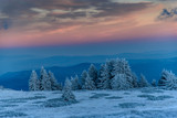 Amazing pink purple winter sunset in the mountains - beautiful frozen landscape - colorful panorama