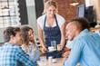 Waitress serving at table