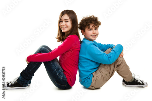 Fotografiet Girl and boy sitting on white background