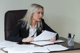 beautiful business woman working at her office desk with documents
