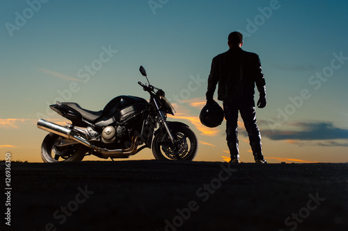 Plakat Silhouette of man in leather outfit with motorbike