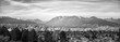 Monochrome Vancouver Cityscape with Surrounding Mountains