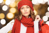 woman in red hat and scarf holding shopping bags