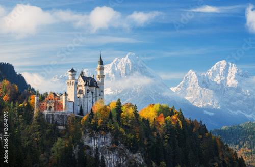Leinwanddruck Bild Famous Neuschwanstein Castle with scenic mountain landscape near Füssen, Bavaria, Germany