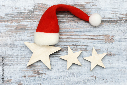 Poster star  with santa hat on wood