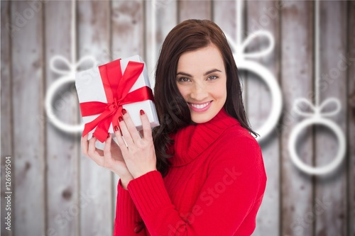 Poster Beautiful woman holding a christmas gift