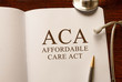 Page with ACA (Affordable Care Act) on the table with stethoscope, medical concept