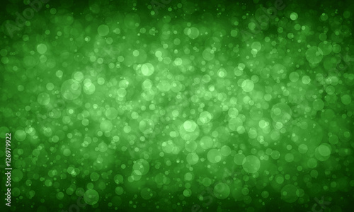 green bokeh background, white Christmas lights blurred on green background, green glitter or sparkle background design for the holiday