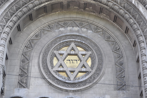 Foto op Plexiglas Buenos Aires the tetragrammaton YHWH combined with the star of David, at the front of a synagogue in Buenos Aires