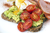 Avocado Toast with Cherry Tomatoes Poached Egg and Bacon Top Vie