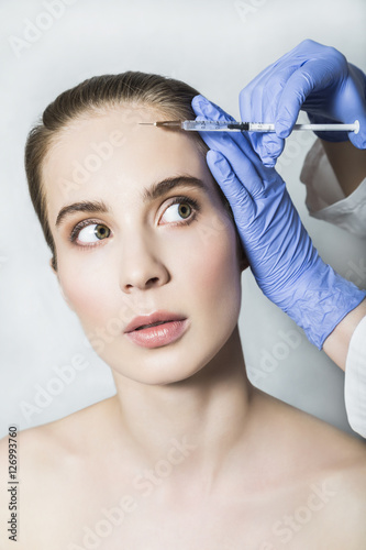 Doctor aesthetician makes face beauty injections to female patient © pavelgulea