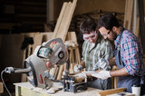 Two men builder with circular saw having a conversation