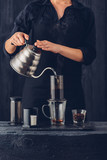 Professional barista preparing coffee alternative method - 127002146