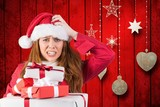 Fototapety Confused woman in santa costume with a stack of christmas gifts