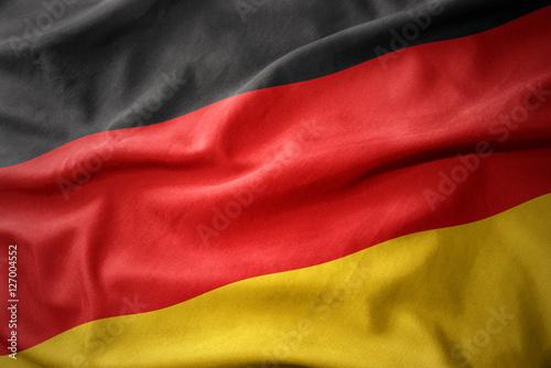 Leinwanddruck Bild waving colorful flag of germany.