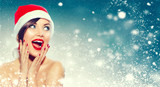 Christmas. Beautiful surprised woman in Santa