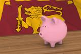 Sri Lanka Finance Concept - Piggybank in front of Sri Lankan Flag 3D Illustration