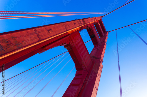 Poster Low Angle Red Golden Gate Bridge Tower Blue Sky
