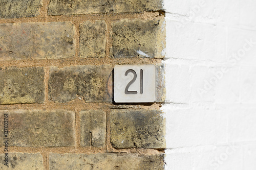 Poster House number 21 sign on wall