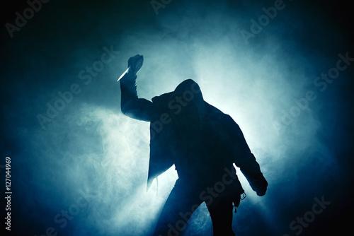 Poster Silhouette Hand Hooligan Nebel blau Messer