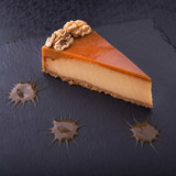 tasty piece of cake on stone slate
