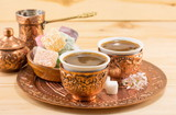 Coffee and Turkish delight in a copper cups