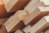 Wood timber construction material for background and texture. close up. Stack of wooden bars. small depth of field - 127110735