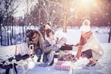 Composite image of happy family holding presents