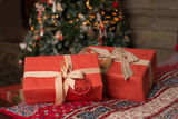 Boxes with gifts lying under the Christmas tree