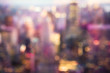 Defocused abstract metropolitan city blur of buildings with lens flare shot in New York City