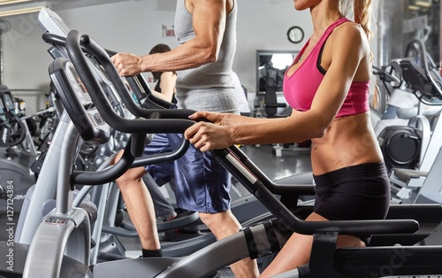 people on elliptical trainer © Kurhan