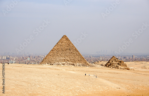 Ancient Egyptian pyramids of Giza against sandy sky