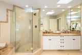 Fototapety Luxury bathroom interior in marble with glass shower and round double sink.