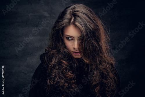Poster Brunette female dressed in a black sweater.