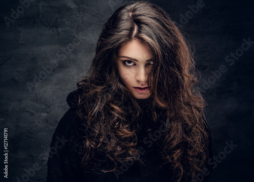 Poster Brunette female dressed in a black sweater.