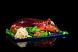 baked piglet on black background - 127144576
