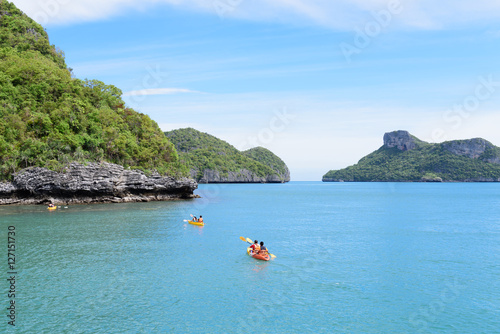 Poster Tourist kayaking in the Thai ocean from backward view