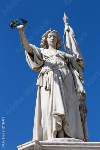 Zdjęcia Brescia - The statue of victory as the memorial of Italian war again Austria on the Piazza della Loggia square - Monumento alla Bella Italia by Giovanni Battista Lombardi (1864)