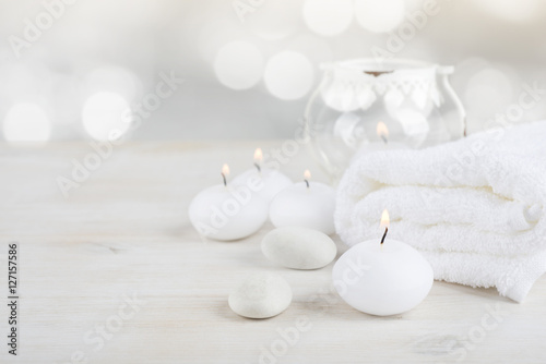 Fotobehang Spa Spa resort therapy composition. Burning candles, stones, towel, abstract lights