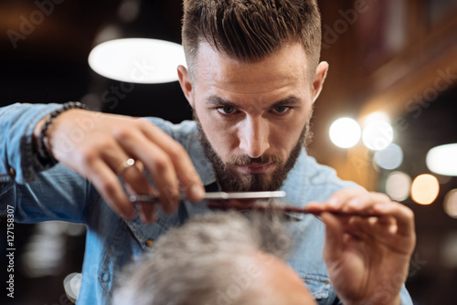 Close up of young male hairdresser cutting hair Poster