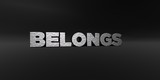BELONGS - hammered metal finish text on black studio - 3D rendered royalty free stock photo. This image can be used for an online website banner ad or a print postcard.